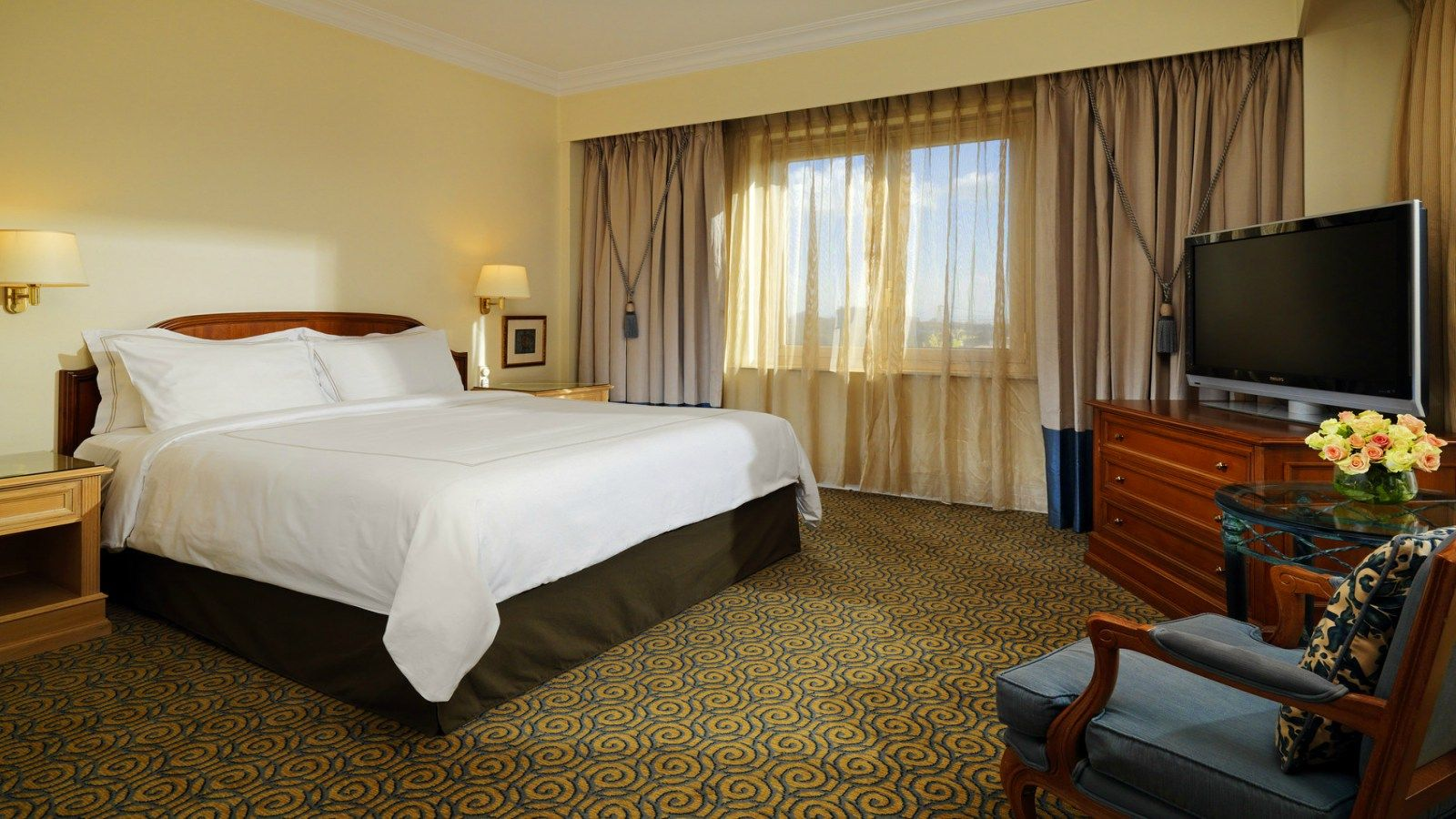 Classic Suite Room interior with Flat Screen TV in front of bed