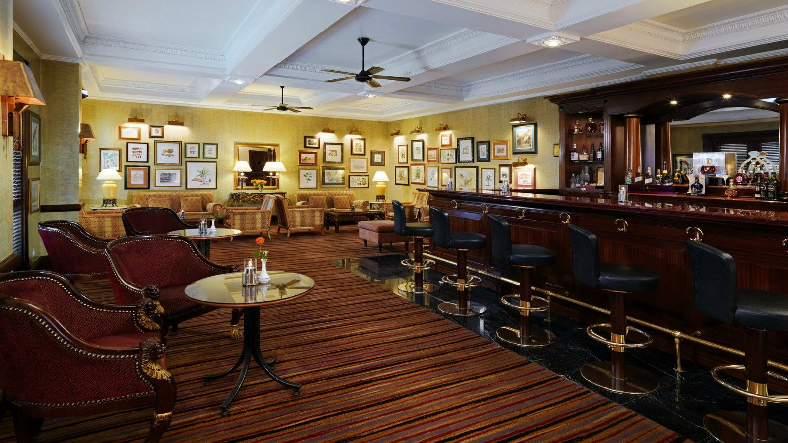 Stanley's bar interior with wooden framed pictures covering the wall