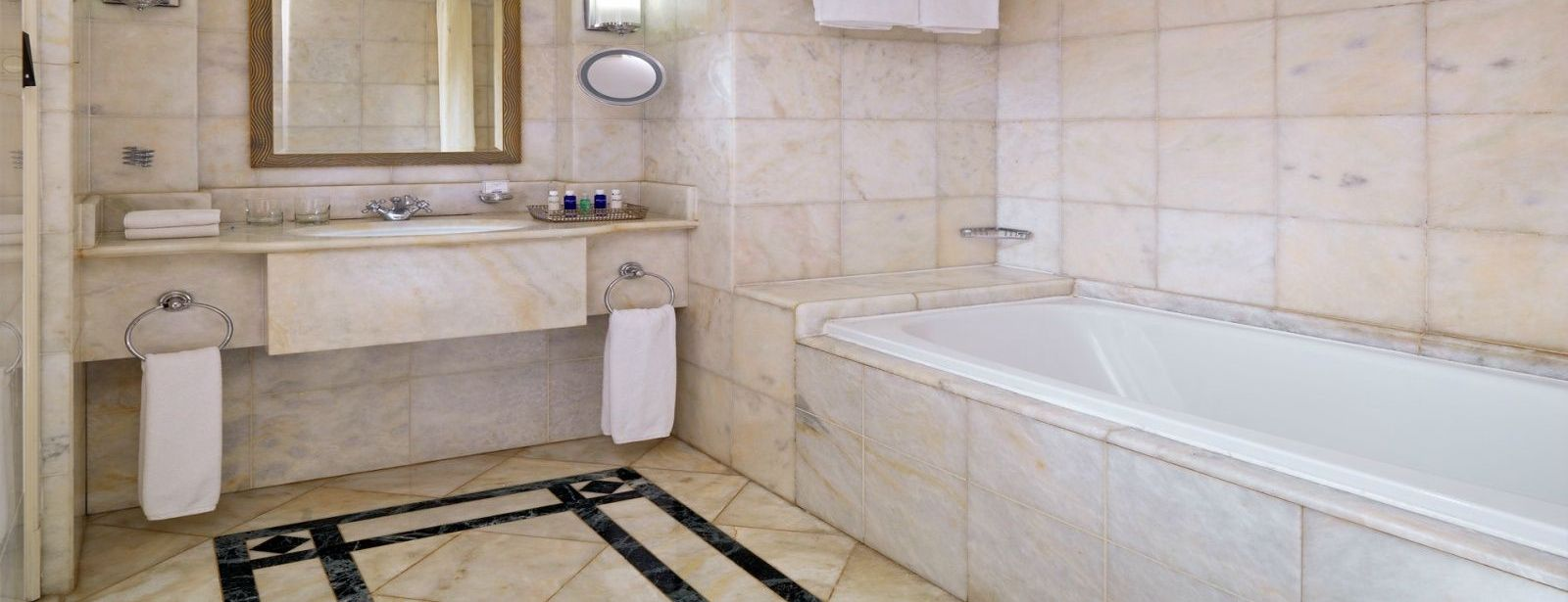 Classic Suite spacious bathroom interior with bath and walk in shower