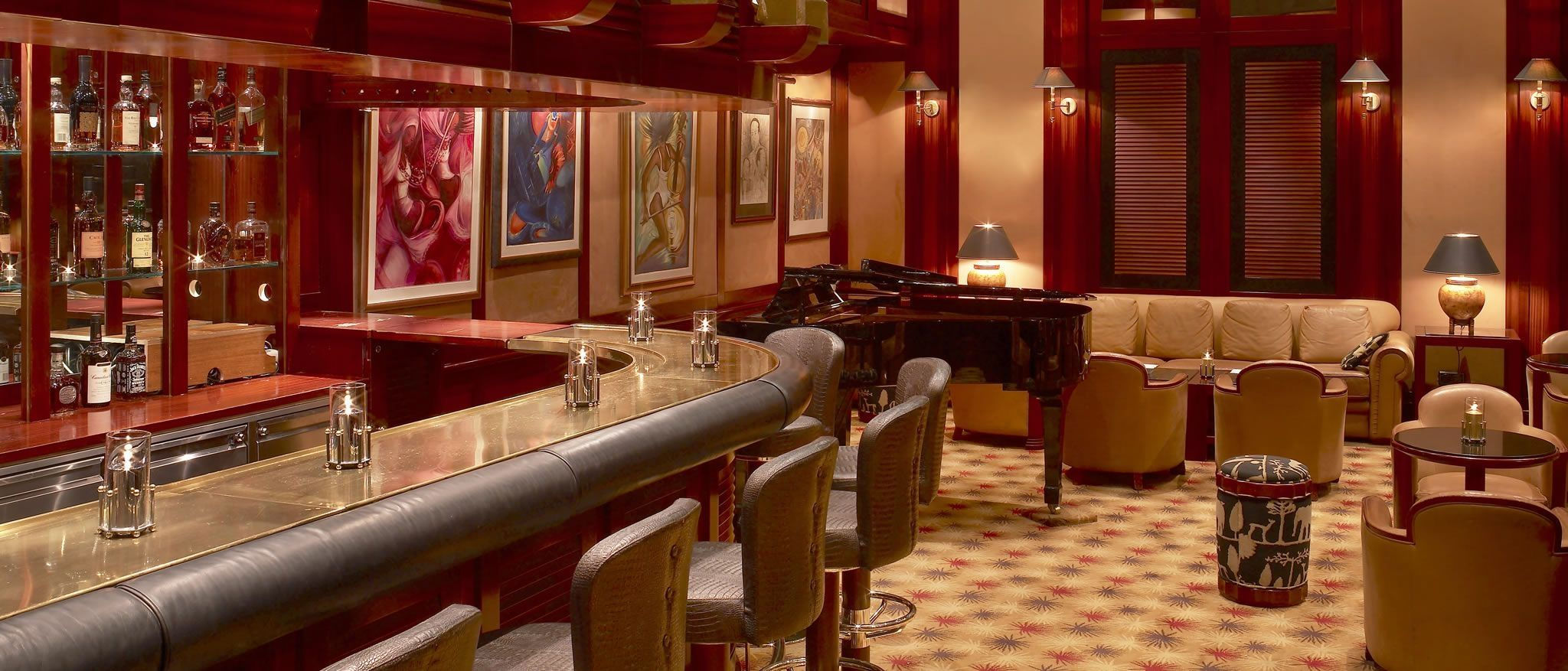 Luxurious Bar to the left with Grand Piano and inviting lounge to the right